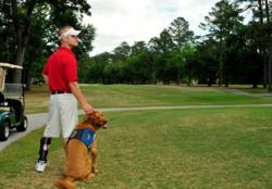DeBevoise with his service dog, Rusty