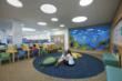 The children's reading area has a tide pool in its midst; notice the colors, textures, and patterns of the carpet, also made with recycled contents.