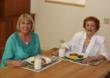 "Barb Anderson (right), the ""mom"" of Mom's Meals, sharing a meal with her own mother."