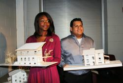 Levitta Lawrence and Andres Ormeno stand with their winning designs.