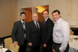 Security America Mortgage staff members Steve Otero, Garrett Puckett, and Sebastian Burfitt pose for a photo with ret. Brig. Gen. Creighton Abrahams at an Association of the United States Army breakfast.