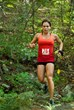 A runner enjoys narrow single track trail typical of this Southeastern trail running series.