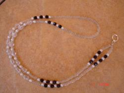 This lanyard is designed with Garnet Swarovski crystals and white pearls.