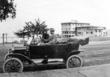 Local Couple in Ford Model T in front of the Colonial.  Circa  1913.