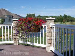 Cobblestone pillars pair well with wooden fencing to create a great looking deck edging