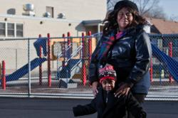Nathan Weber for the New York Times features parent Keisha Allen and her son, Isaac Lampley, 3, in Chicago.