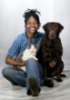 Grooming Expert Taria Avery with her two fur-kids Avery, the chocolate lab, and Tiger Lily, the cat.