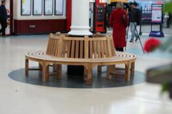 an engraved round tree bench supplied by a leading supplier of outdoor garden furniture chic teak was recently unveiled at hull paragon station by the chic teak furniture
