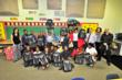 TCG Distributes Backpacks Filled With Toys and School Supplies to...
