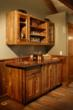 The cabinetry for a game room was crafted from Pioneer Millworks' reclaimed hardwoods, complete with original saw marks, ferrous staining, and deep patina.