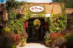 The entry to Albuquerque's Historic El Pinto Restaurant in New Mexico invites guests to enjoy a memorable dining experience.