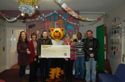 Staff and Young People from Suffolk Young People's Health Project receive the cheque from Tiger.co.uk