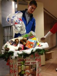 Dr. John Dandelski dropping off toys in December