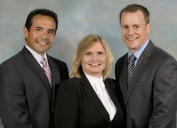 Michael Hernandez, CFP, Barbara Stowell and Shawn Hochuli of IWM Partners