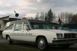 An earlier Applied Communications Services vehicle - a white hearse with a microwave antenna.