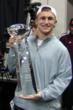 Johnny Manziel lifts the CFPA Trophy