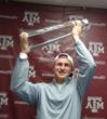 Johnny Manziel hoisting the CFPA Trophy