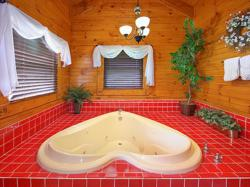 Romantic Gatlinburg cabin featuring a heart-shaped Jacuzzi
