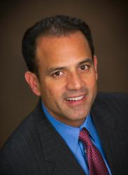 Professional headshot for Glenn Ayala, Director of Global Business Development for TTS.