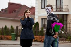 masked man asking a woman out