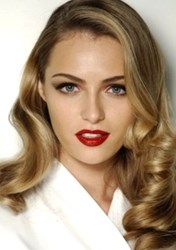 Romantic curls and red lipstick are beauty go-to favorites for Valentine's Day.