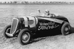 Welcome to Mines Field, the future home of the Los Angeles International Airport. We've turned back the clock to February 18, 1934 when the AAA (American Automobile Association) held a stock car race there. We see Al Gordon behind the wheel of his Westwoo
