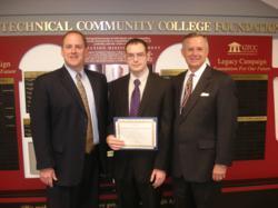 Crumley Roberts CEO presents scholarship winner, Darren Lipman