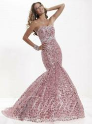 Tiffany Designs style 16745 features sequin-embroidered lace with a tulle mermaid skirt.