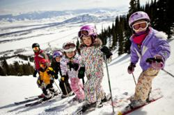 Kids enjoying the slopes on their ski vacation in Jackson Hole.