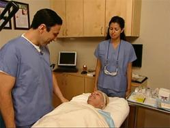 Dr. Simon Ourian examines a patient for cosmetic surgery