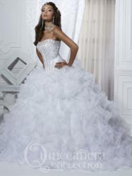 Quinceanera Collection style 26716 with a full cascading ruffle skirt is available in royal, light pink, and white.
