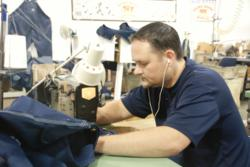 Round House employee Jeff Lawerance sewing a pair of American Made Round House jeans.