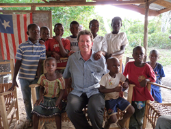 Bird-B-Gone Owner Bruce Donoho visits with COTN sponsored children