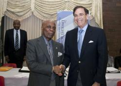 1199 Housing Corporation President William Dames and Dwight School Chancellor Stephen Spahn Shake Hands