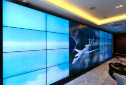 The Jet Business deploys 32-monitor Mura MPX-powered video wall controlled using Mura Network Application Programming Interface.