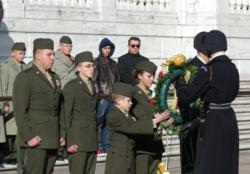Youth members of the Young Marines laying a wreath at the Tomb of the Unknown Soldier at Arlington National Cemetery. L to R: LCPL  D. Lindquist, SSgt  M. Reveile, Cpl  I. Watson, and LCPL  K. Bray