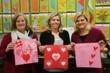 AccuQuilt staff join in the fun by creating quilt blocks to support Go Red for Women.