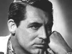Lefty Cary Grant leaning on his left hand