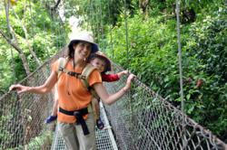 Travel blogger Shelly Rivoli with toddler son at Hanging Bridges in Costa Rica