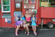 Family travel author and blogger Shelly Rivoli with her kids in Hanalei, Kauai