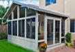 A sunroom with opening windows and screening by Venetian Builders, Inc., Miami, has French doors, available as an option.
