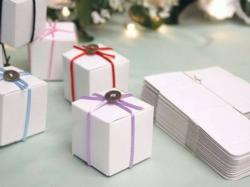 DIY Wedding Favor Boxes are a popular way to cut costs!