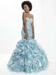 Tiffany Designs style 16753 graces the back cover of Pageantry in a shimmering aqua-blue metallic organza.
