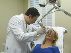 Dr. Simon Ourian performing laser skin resurfacing treatment