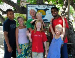 Bridge the Gap Villages co-founders, Jenny and Jimmy Cahill, with their children, Lucas, Oliver and Bethany, flanked by Fijian friends, Nemani and Boso on Vorovoro Island in Fiji