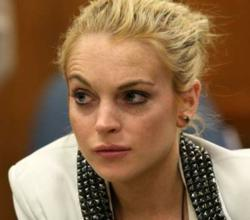 Lohan refuses drug treatment in court by firing her lawyer
