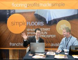 Surfaces 2013 simpleFLOORS Franchise Opportunity Booth w/ Rocky and Drew
