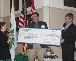 Jim Cupp presenting the check Handy gave to the MD 4-H Foundation