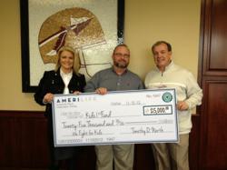 (From Left to Right) Candi Fisher, AmeriLife CEO Timothy O. North, FSU Head Football Coach Jimbo Fisher.