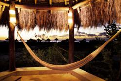 Watch the sun set from your hammock at Xixim